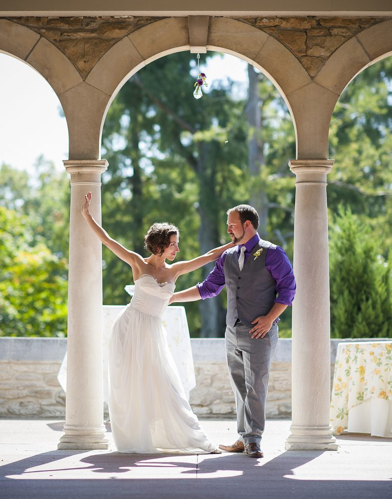 dancing bride with groom under an arch at Alms Park, Cincinnati, Ohio
