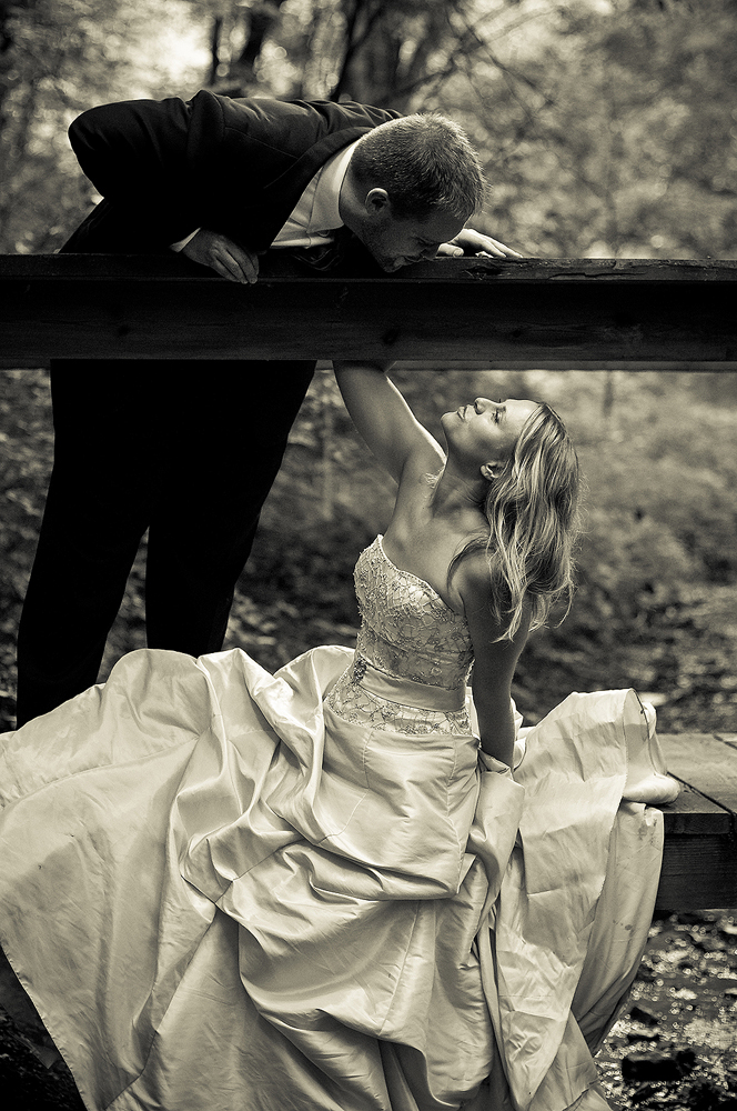 bride and groom in black and white in the forest at Ault Park, Cincinnati, Ohio