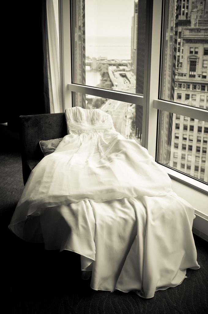 wedding dress laying on a couch in Trump Tower Chicago