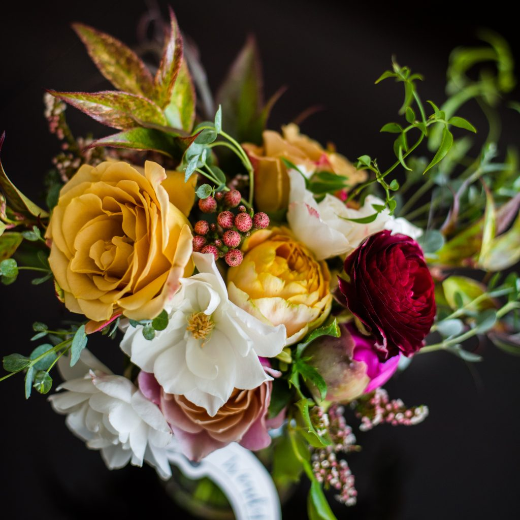 luxurious flowers in a wedding bridal bouquet for fall with roses, berries and lilies for a fall wedding in Boston