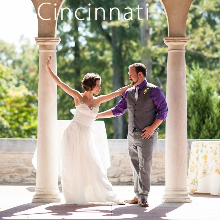 ballerina bride and groom dancing under an arch at Alms Park in Cincinnati Ohio