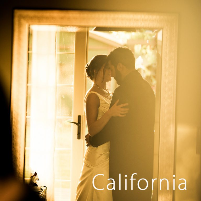 bride and groom embracing in sunset light at their central California winery wedding