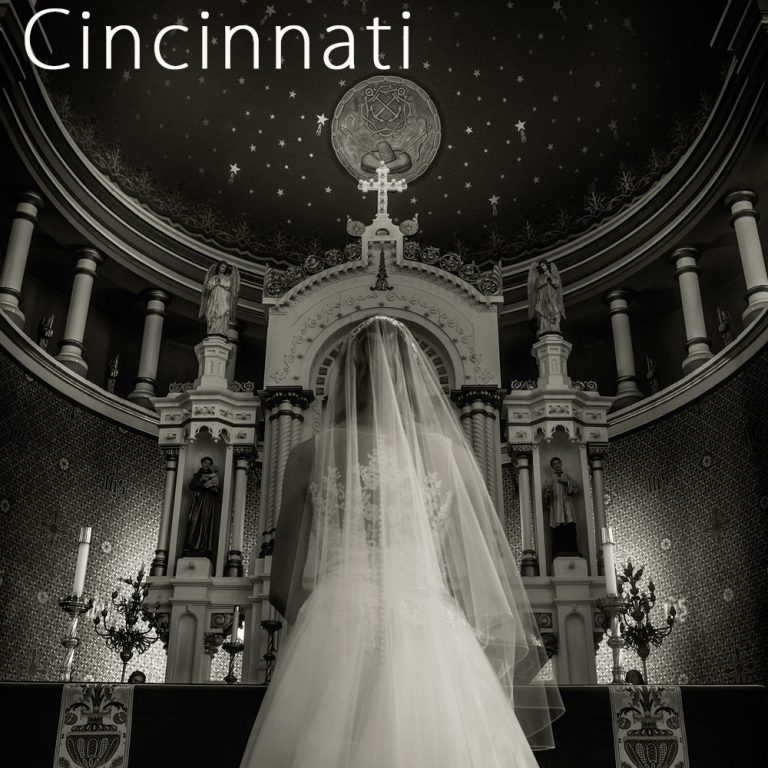 dramatic black and white photo of the back of a bride's dress at st Rose church in Cincinnati