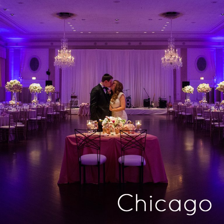 bride and groom kissing in the romantic light of the ballroom at The Standard Club in Chicago